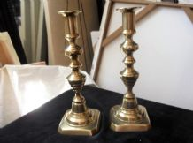 PAIR OF VERY OLD SOLID HEAVY BRASS CANDLESTICKS FACETED DETAIL AT TOP 9""